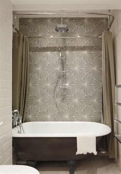 luxury bathroom with a ceiling mounted shower curtain rail