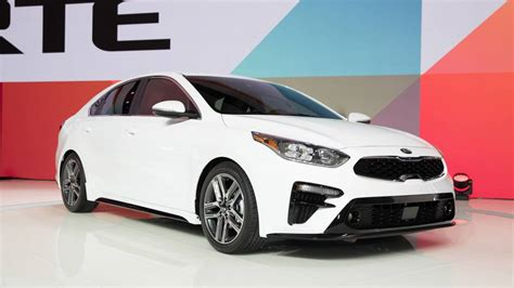 kia reveals  forte  stinger tinged design