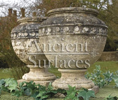 antique stone planters  pedestals  ancient surfaces