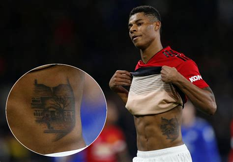 Rashford has huge tattoo of young boy playing football in ...