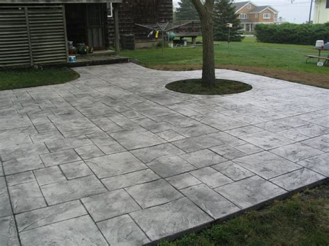 Cement Patio by Patios Design Concrete Corp