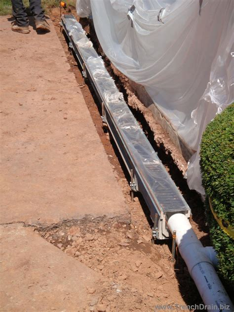 install driveway drain trench drain installation for the residential driveway trenchdrainblog com