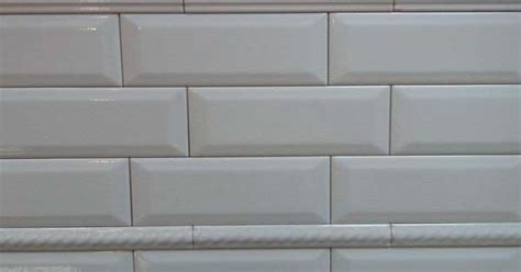 Subway tile with beveled edges and rope trim   Arden