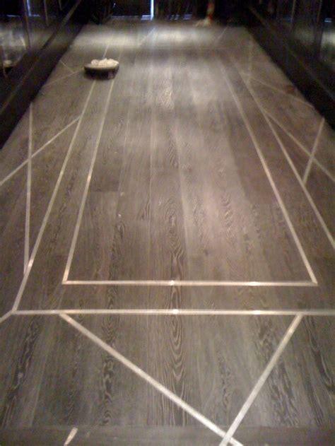 concrete kitchen flooring wood floor with metal inlay design detail 2428
