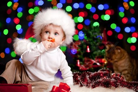 Santa Claus With Maiden In Bright Clothes Stock Baby In Santa Claus Hat On Bright Festive Background