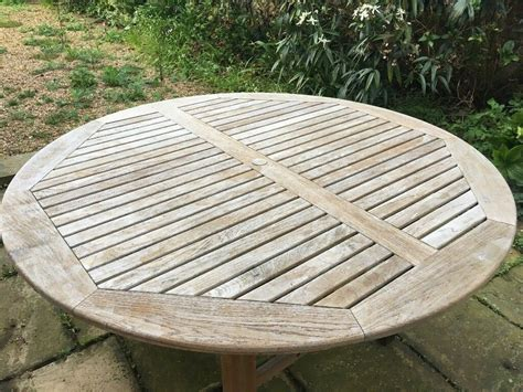 solid teak garden table   chairs  covers