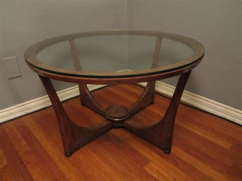 Featuring a combination of open design and hidden storage this mid century modern coffee table is both functional and on trend. Vintage Mid Century Round Wood and Glass Coffee Table | Flickr - Photo Sharing!