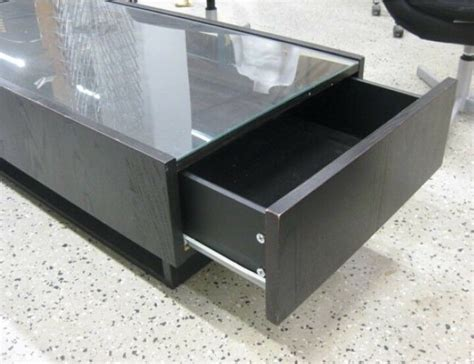 Underneath is space for various books or magazines. IKEA (HEMNES) glass top coffee table with storage | in Hayes, London | Gumtree