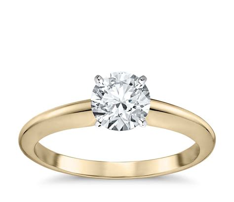 classic four prong solitaire engagement ring in 18k yellow gold blue nile