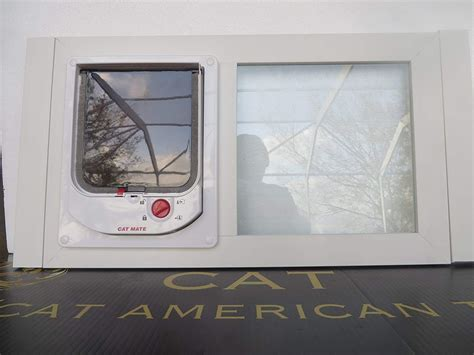 cat electromagnetic white vinyl glass sash window   inches wide  locking    pet door