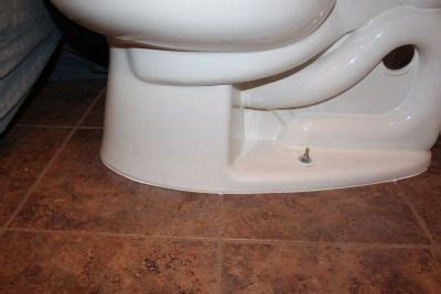 How to Fix a Loose, Rocking Toilet