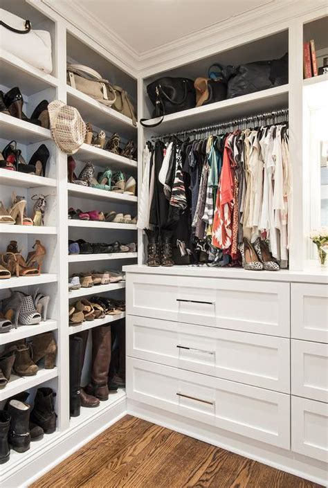 walk in closet with built in shoe shelves transitional