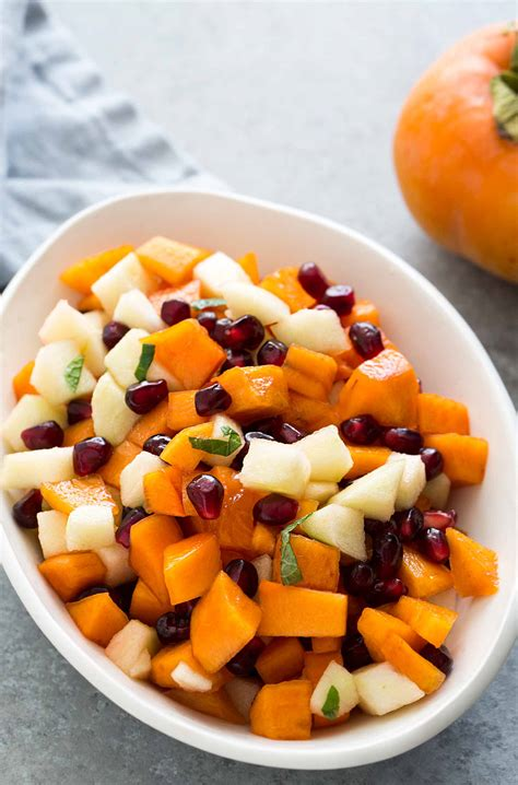 cajun cuisine persimmon pomegranate fruit salad recipe simplyrecipes com
