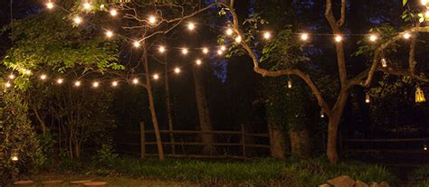 hanging string lights how to hang patio lights yard envy