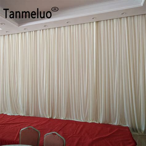 pure white fabric backdrop drapes curtains wedding