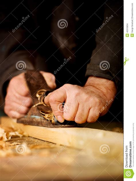 senior man  woodworking stock photo image