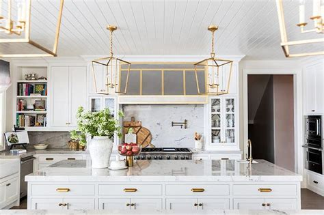White Beadboard Kitchen Ceiling with Antique Brass Darlana