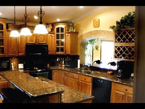 granite countertops for oak kitchen cabinets honey oak kitchen cabinets with granite countertops 8337