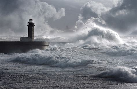 storm waves   lighthouse stock photo