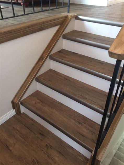 vinyl plank flooring for stairs kubik residence vinyl planks lvp rustic staircase calgary by cochrane floors more