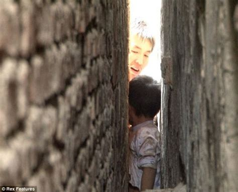 Chinese Boy Gets Stuck In Wall Playing Hide And Seek