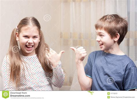 Boy And Girl Show Each Other Stock Photography Image