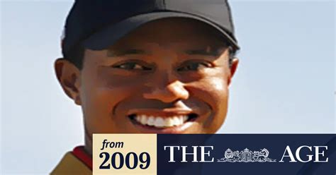 In a a sign post damaged by the car crash of tiger woods is seen as the car is towed away, february 23, 2021. Tiger Woods injured in serious car crash