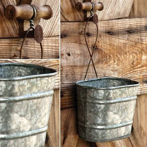 Galvanized metal is essential for farmhouse decorating style. Galvanized Hanging Buckets, Set of 3 | Galvanized wall planter, Antique farmhouse