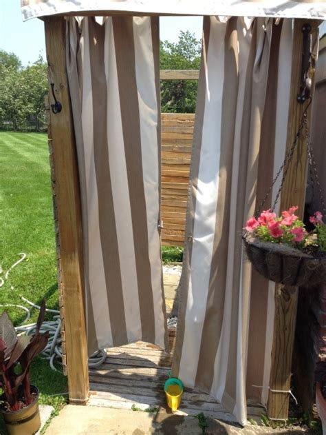 outdoor shower with striped curtain garden ideas