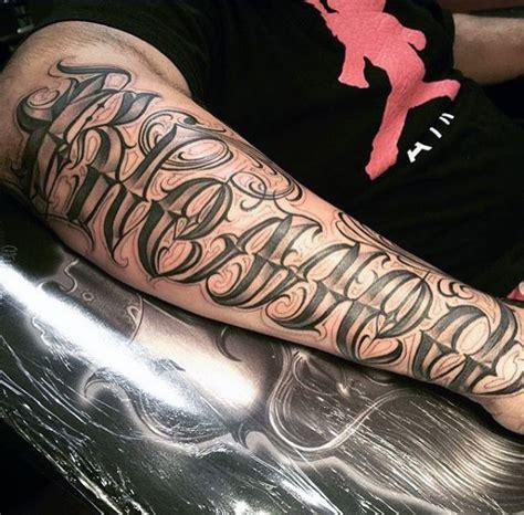 tattoo lettering designs  men manly inscribed ink