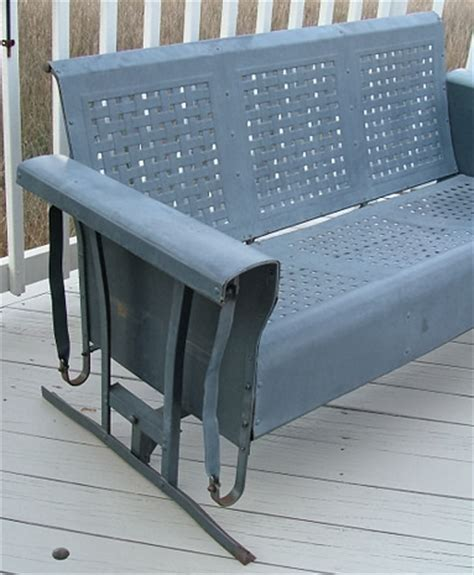 vintage three seat metal porch glider and two chairs for