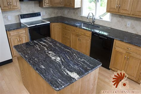 cosmic black granite countertops with a crema marfil tile