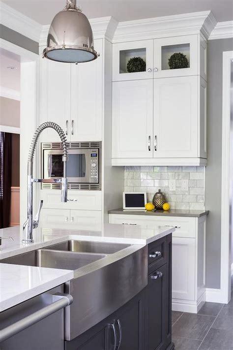 White Kitchen with Gray Slate Herringbone Floor Tiles