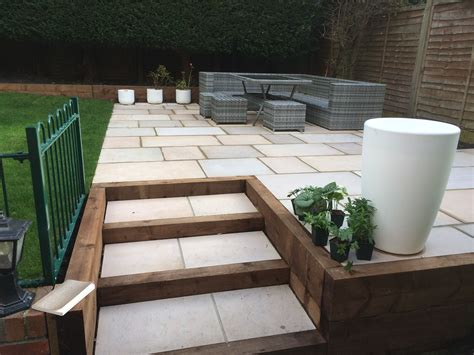Patio Areas In Gardens by Raised Patio Area With Incorporated Steps Within Timber