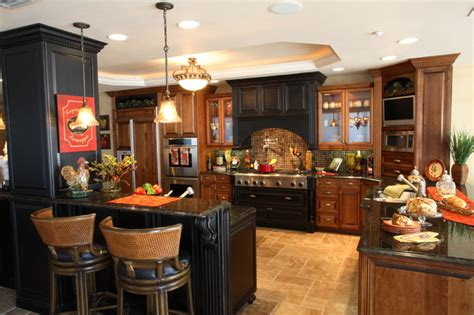 Now only kitchens but bathrooms and furniture for living and living areas. Tuscan Villa - Traditional - Kitchen - tampa - by Michelle Miller Design, Inc.
