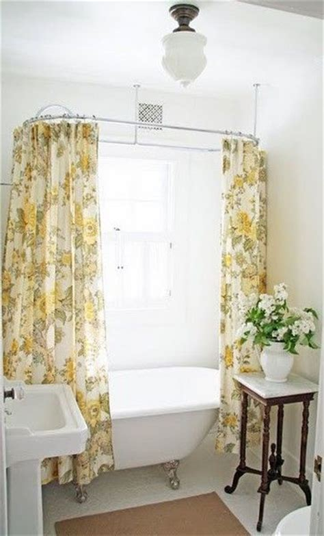 dual shower curtain on the clawfoot tub master suite