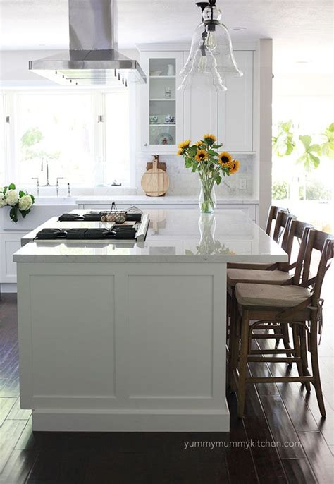 kitchen island with stove top beautiful white marble kitchen remodel traditional