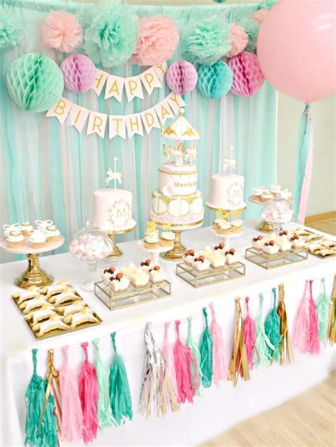 a pink gold carousel 1st birthday party party ideas pink mint and gold carousel cake dessert table chérie