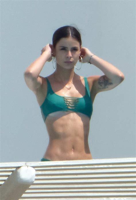 Lena Meyer-Landrut in a green bikini enjoying a vacation