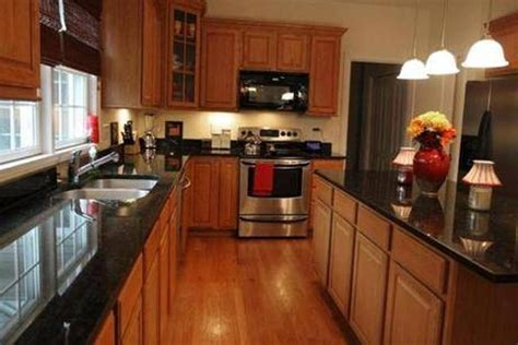 Black Cabinets With Marble Countertops by Black Granite Kitchen Countertops Oak Cabinets Google