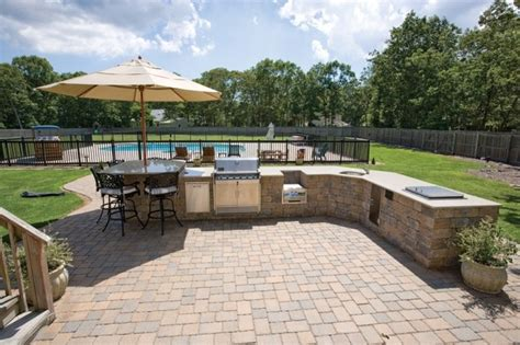 custom brick patio with outdoor kitchen traditional
