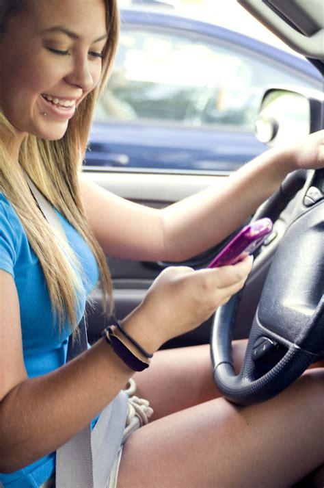 driving teen  stock photo  teen girl texting