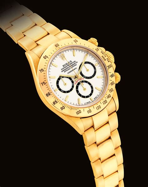 ROLEX. A VERY RARE AND FINE 18K GOLD AUTOMATIC CHRONOGRAPH ...