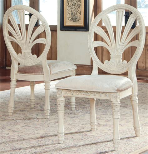 ortanique round glass dining room set d707 50b ashley