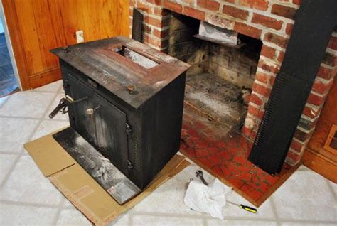 beginning   fireplace makeover removing