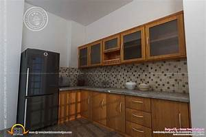 Kitchen design in kerala kerala home design and floor plans for Interior design for kitchen in kerala