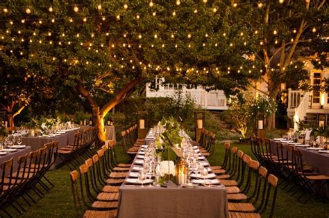 romantic outdoor wedding reception enchanted garden   OneWed.com