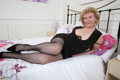 Lux MILF Pics: Pierced British mature lady is getting kinky