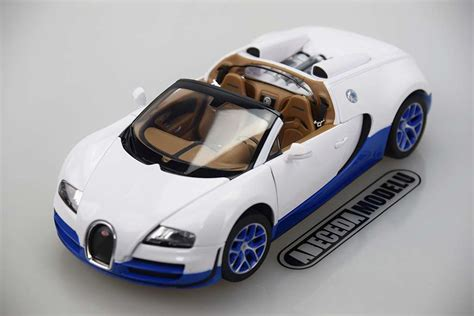 To make the grand sport, bugatti's engineers had to do the same thing, only with a giant hole in the middle. Rastar Bugatti Veyron 16.4 Grand Sport Vitesse (white) 43900