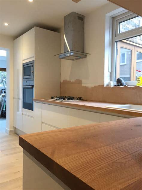kitchen progress howdens white gloss handless units